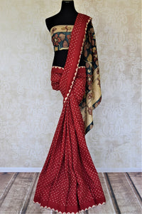Buy red tassar bandhej saree online in USA with hand painted Kalamkari pallu. Choose tasteful Indian sarees for special occasions from Pure Elegance. Our exclusive Indian fashion store has a myriad of stunning pure silk saris, printed sarees, handwoven saris for Indian women in USA.-full view