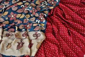 Buy red tassar bandhej saree online in USA with hand painted Kalamkari pallu. Choose tasteful Indian sarees for special occasions from Pure Elegance. Our exclusive Indian fashion store has a myriad of stunning pure silk saris, printed sarees, handwoven saris for Indian women in USA.-details