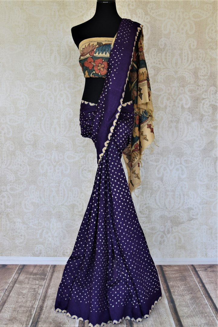 Buy indigo blue tassar bandhej sari online in USA with hand painted Kalamkari pallu. Choose tasteful Indian sarees for special occasions from Pure Elegance. Our exclusive Indian fashion store has a myriad of stunning pure silk saris, printed sarees, handwoven saris for Indian women in USA.-full view