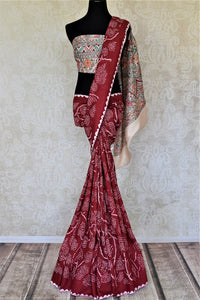 Shop gorgeous red tassar bandhej saree online in USA with Madhubani painting pallu. Choose tasteful Indian sarees for special occasions from Pure Elegance. Our exclusive Indian fashion store has a myriad of stunning pure silk saris, printed sarees, handwoven saris for Indian women in USA.-full view