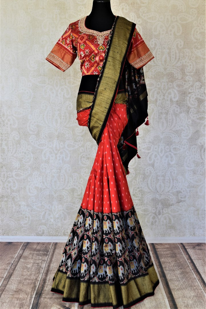 Shop gorgeous red and black patola silk saree online in USA with embroidered blouse. Keep it light yet festive on special occasions with beautiful silk saris, patola sarees from Pure Elegance Indian fashion store in USA.-full view