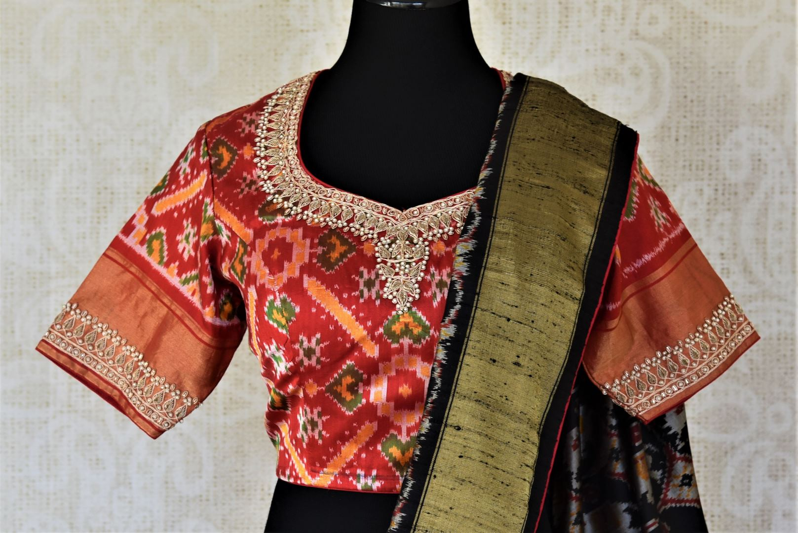 Shop gorgeous red and black patola silk saree online in USA with embroidered blouse. Keep it light yet festive on special occasions with beautiful silk saris, patola sarees from Pure Elegance Indian fashion store in USA.-blouse pallu