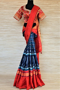 Buy beautiful blue patola silk saree online in USA with red border and embroidered red ikkat blouse. Be a vision of tradition and elegance on weddings and festivals with exquisite silk sarees, patola sarees, handwoven sarees from Pure Elegance Indian clothing store in USA.-full view