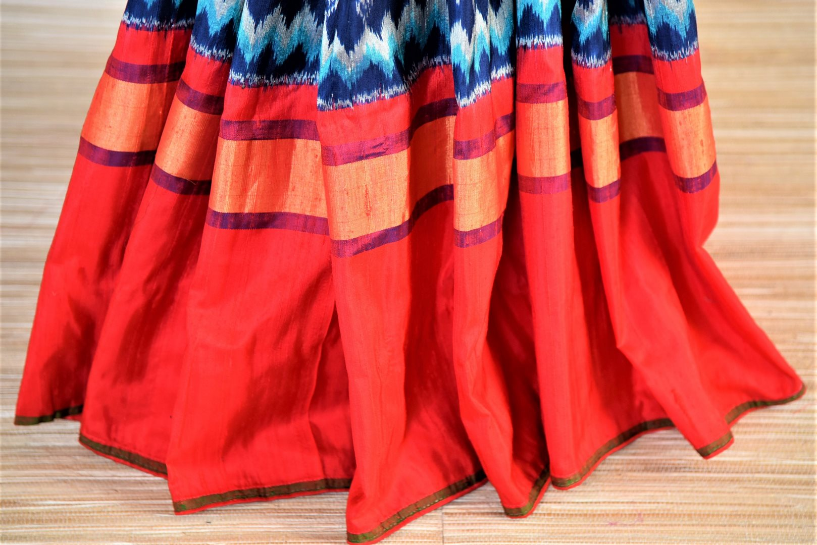 Buy beautiful blue patola silk saree online in USA with red border and embroidered red ikkat blouse. Be a vision of tradition and elegance on weddings and festivals with exquisite silk sarees, patola sarees, handwoven sarees from Pure Elegance Indian clothing store in USA.-blouse pallu