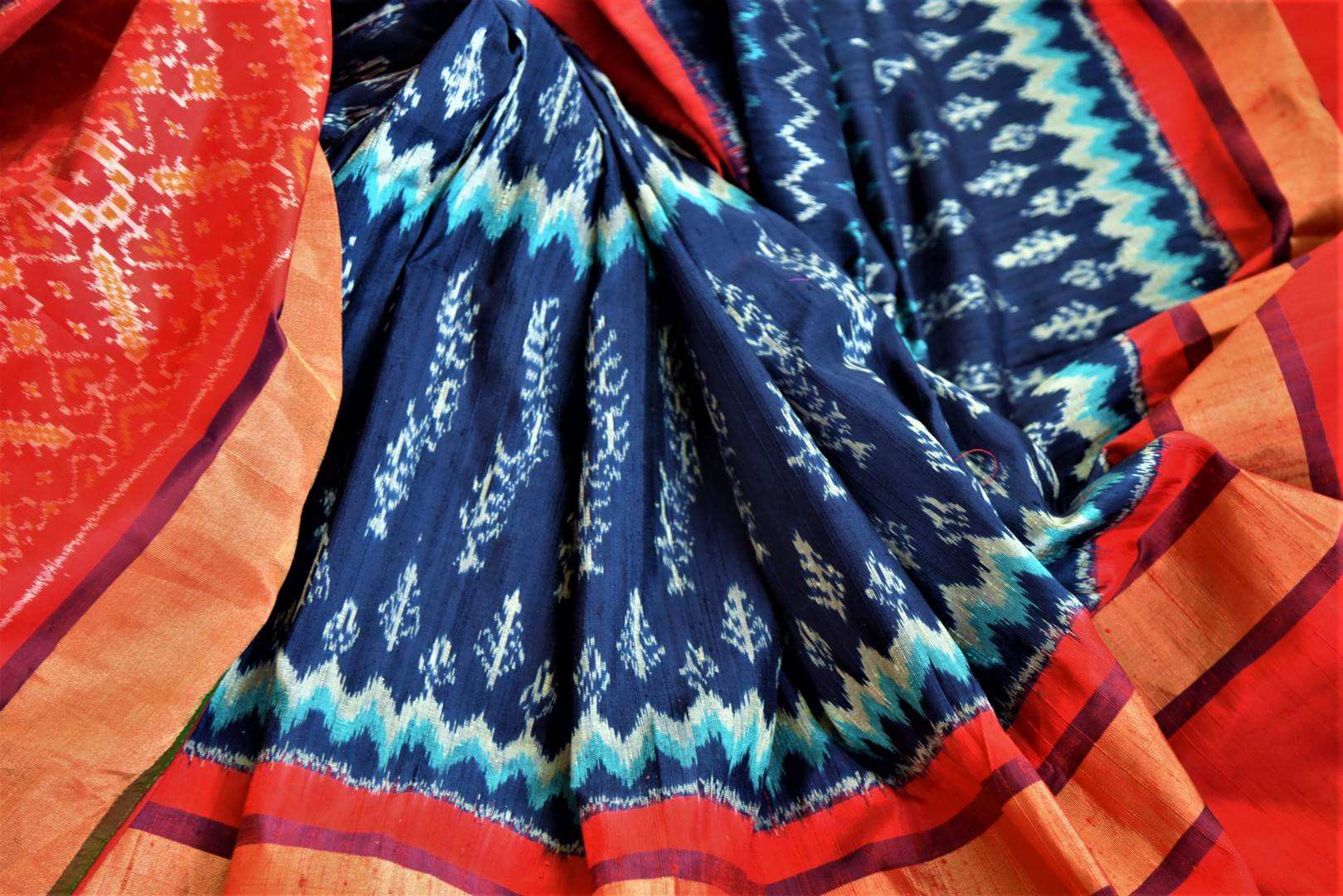 Buy beautiful blue patola silk saree online in USA with red border and embroidered red ikkat blouse. Be a vision of tradition and elegance on weddings and festivals with exquisite silk sarees, patola sarees, handwoven sarees from Pure Elegance Indian clothing store in USA.-details