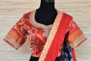 Buy gorgeous blue patola silk sari online in USA with embroidered red ikkat blouse. Be a vision of tradition and elegance on weddings and festivals with exquisite silk sarees, patola sarees, handwoven sarees from Pure Elegance Indian clothing store in USA.-blouse pallu