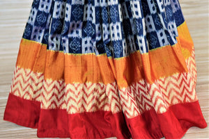 Buy gorgeous blue patola silk sari online in USA with embroidered red ikkat blouse. Be a vision of tradition and elegance on weddings and festivals with exquisite silk sarees, patola sarees, handwoven sarees from Pure Elegance Indian clothing store in USA.-pleats