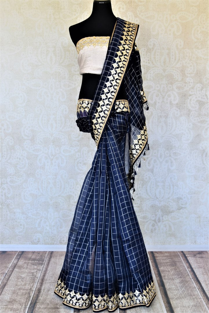 Buy stunning navy blue organza saree online in USA with gota patti work border. Keep it light yet festive on special occasions with beautiful organza silk sarees from Pure Elegance Indian fashion store in USA.-full view
