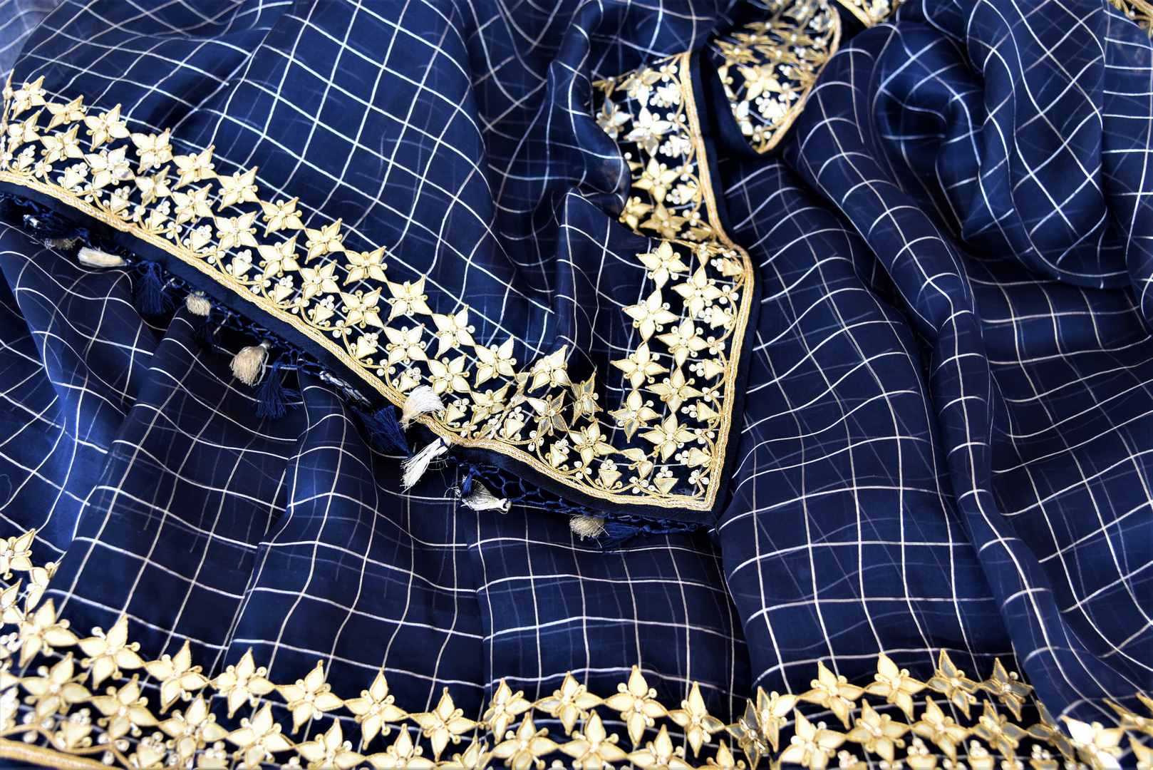 Buy stunning navy blue organza saree online in USA with gota patti work border. Keep it light yet festive on special occasions with beautiful organza silk sarees from Pure Elegance Indian fashion store in USA.-details