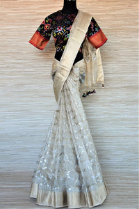 Buy stunning cream chanderi silk saree online in USA with patola ikat saree blouse. Go for a distinct and tasteful saree style on special occasions with handwoven sarees, chanderi silk sarees with blouse from Pure Elegance Indian fashion store in USA.-full view
