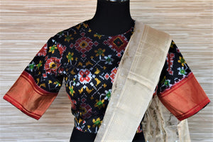 Buy stunning cream chanderi silk saree online in USA with patola ikat saree blouse. Go for a distinct and tasteful saree style on special occasions with handwoven sarees, chanderi silk sarees with blouse from Pure Elegance Indian fashion store in USA.-blouse pallu