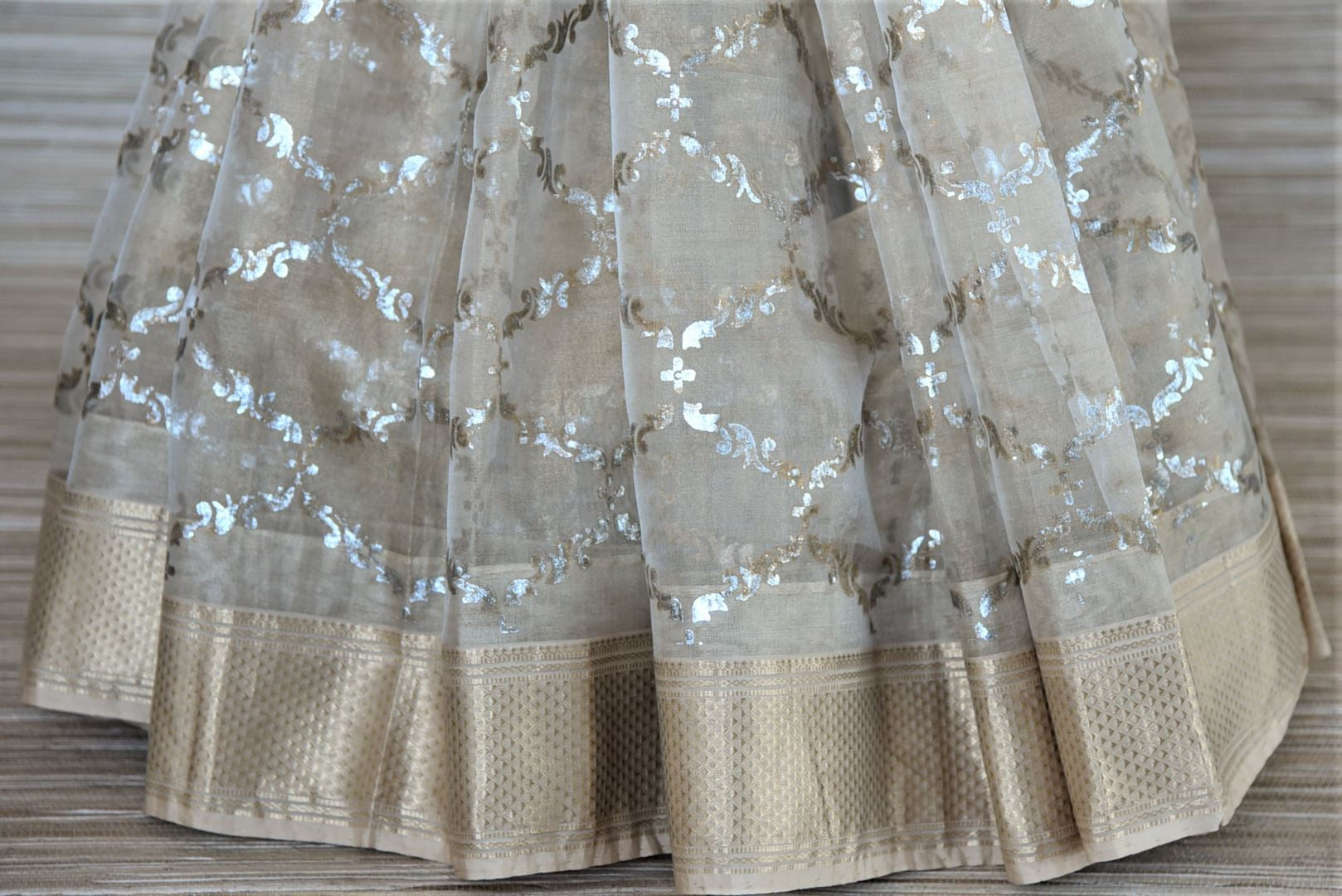 Buy stunning cream chanderi silk saree online in USA with patola ikat saree blouse. Go for a distinct and tasteful saree style on special occasions with handwoven sarees, chanderi silk sarees with blouse from Pure Elegance Indian fashion store in USA.-pleats