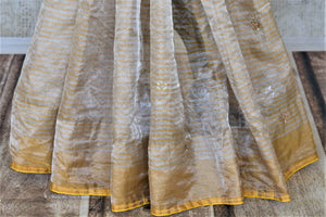 Buy beautiful beige gota patti zari tissue saree online in USA with yellow embroidered blouse. Be the center of attraction at parties and weddings with beautiful tussar silk sarees, pure silk sarees, embroidered sarees, handloom saris from Pure Elegance Indian fashion store in USA.-pleats