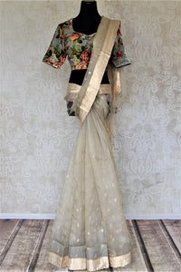 Buy cream embroidered organza saree online in USA with floral velvet blouse. Keep it elegant on special occasions with tussar silk sarees, designer sarees with blouse from Pure Elegance Indian fashion boutique in USA. We bring a especially curated collection of ethnic sarees for Indian women in USA under one roof!-full view