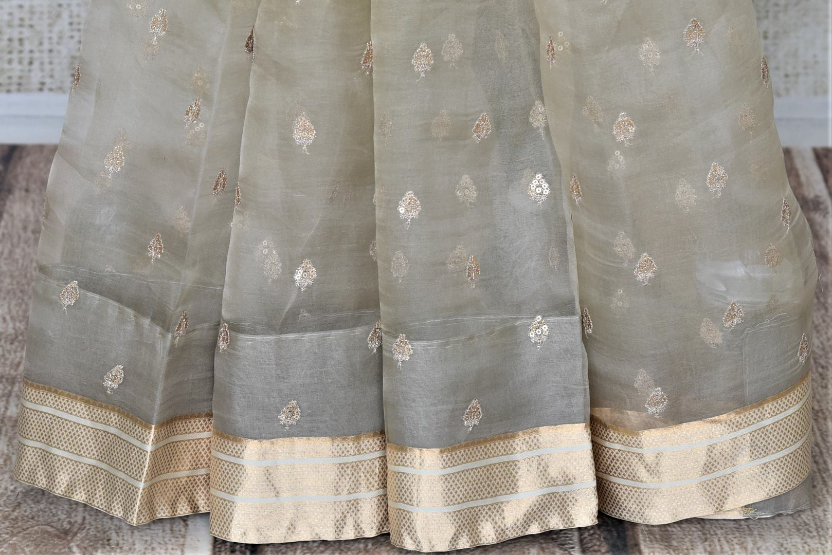 Buy cream embroidered organza saree online in USA with floral velvet blouse. Keep it elegant on special occasions with tussar silk sarees, designer sarees with blouse from Pure Elegance Indian fashion boutique in USA. We bring a especially curated collection of ethnic sarees for Indian women in USA under one roof!-pleats