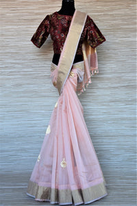 Shop attractive powder pink chanderi silk saree online in USA with printed maroon saree blouse. Go for a distinct and tasteful saree style on special occasions with handwoven sarees, chanderi sarees with blouse from Pure Elegance Indian fashion store in USA.-full view