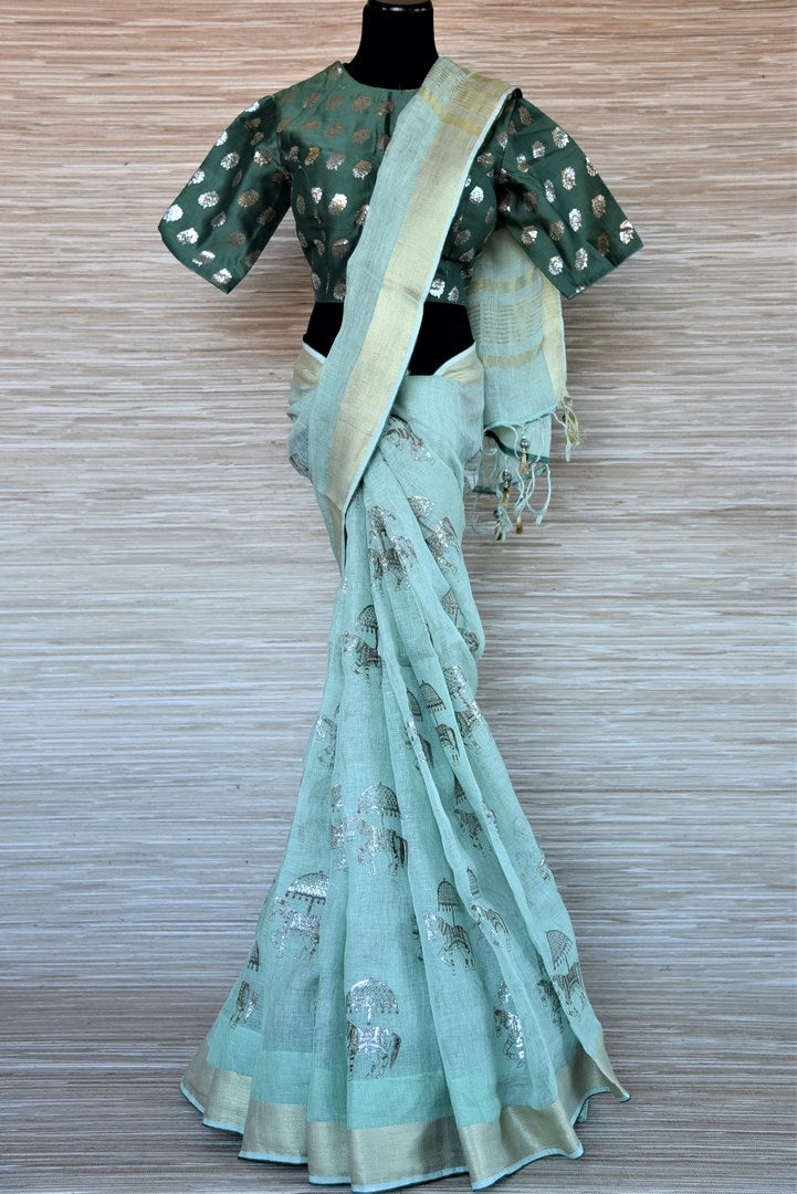 Shop beautiful mint green khari print linen saree online in USA with green saree blouse. Go for a distinct and tasteful saree style on special occasions with handwoven sarees, linen sarees with blouse from Pure Elegance Indian fashion store in USA.-full view