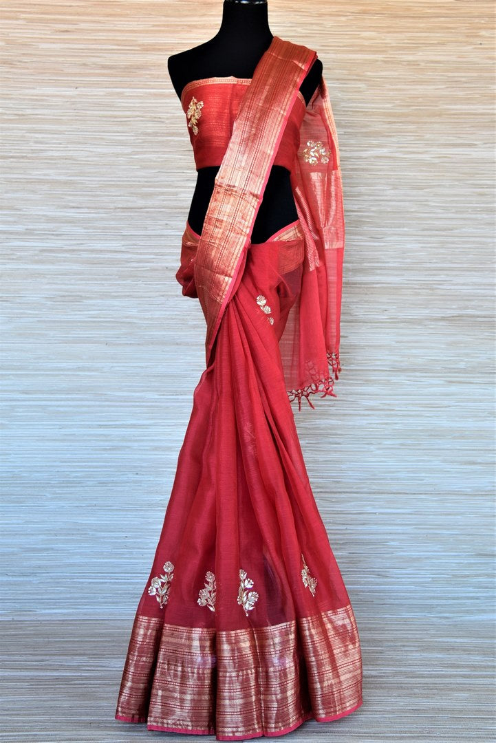 Shop red gota patti embroidery chanderi saree online in USA with zari border. Go for a distinct and tasteful saree style on special occasions with handwoven sarees, chanderi sarees with blouse from Pure Elegance Indian fashion store in USA.-full view