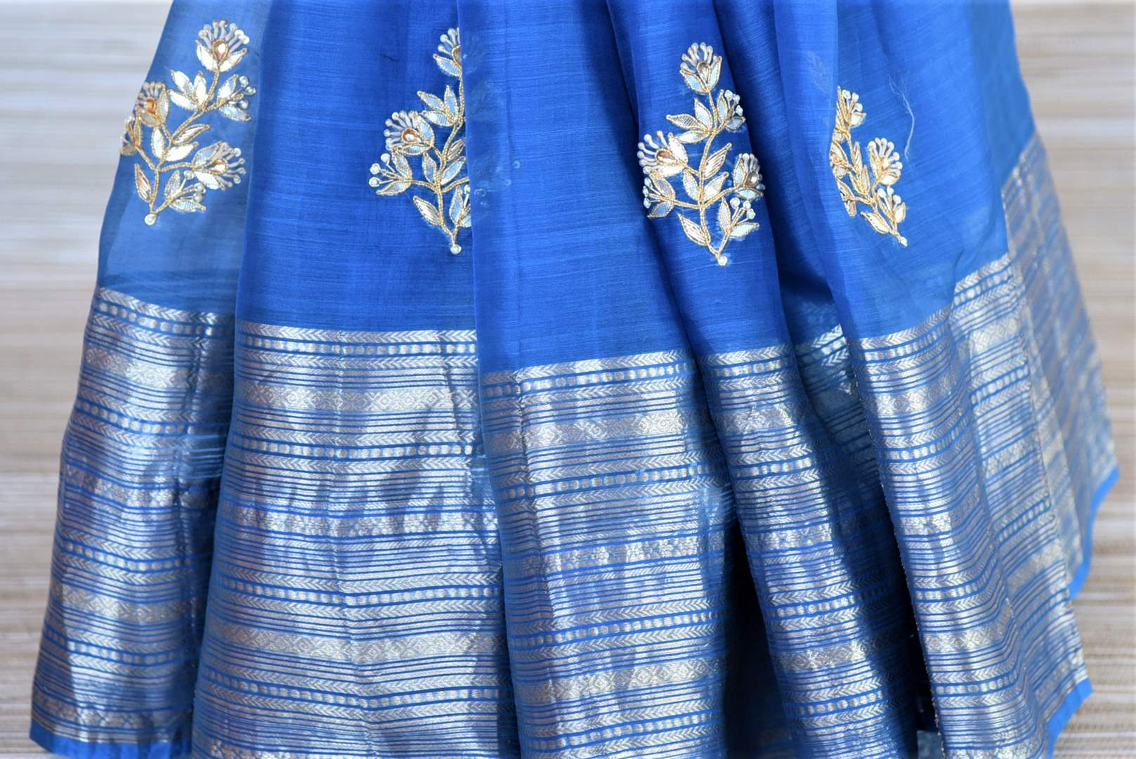Buy blue gota patti embroidery chanderi sari online in USA with zari border. Go for a distinct and tasteful saree style on special occasions with handwoven sarees, chanderi sarees with blouse from Pure Elegance Indian fashion store in USA.-pleats