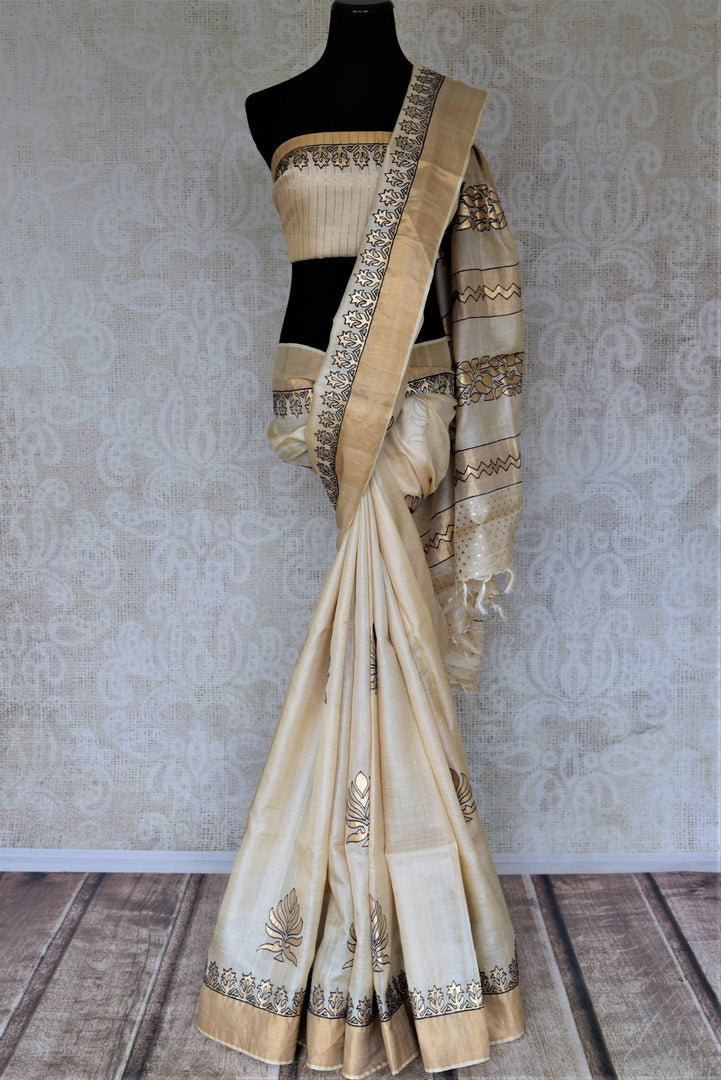 Buy elegant cream tassar silk saree online in USA with khari print zari border. Keep it light yet festive on special occasions with beautiful organza silk sarees from Pure Elegance Indian fashion store in USA.-full view