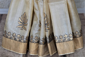 Buy elegant cream tassar silk saree online in USA with khari print zari border. Keep it light yet festive on special occasions with beautiful organza silk sarees from Pure Elegance Indian fashion store in USA.-pleats