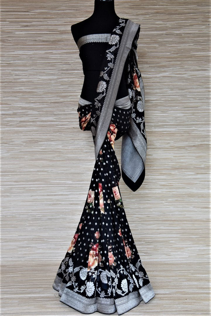 Buy beautiful black floral print georgette Banarasi saree online in USA with stone work. Be the highlight of the parties and festive occasions with tasteful Banarasi sarees, georgette saris, embroidered designer sarees from Pure Elegance Indian fashion store in USA.-full view