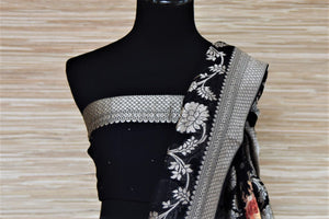 Buy beautiful black floral print georgette Banarasi saree online in USA with stone work. Be the highlight of the parties and festive occasions with tasteful Banarasi sarees, georgette saris, embroidered designer sarees from Pure Elegance Indian fashion store in USA.-blouse pallu