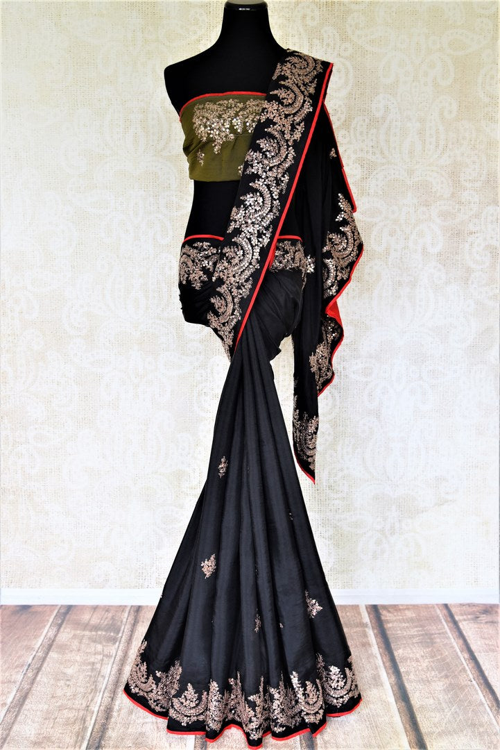 Shop stunning black silk saree online in USA with embroidered border. Be the center of attraction at weddings and parties with beautiful silk sarees, embroidered sarees, partywear sarees, fancy sarees from Pure Elegance Indian fashion store in USA. -full view