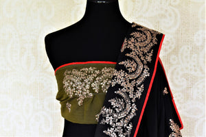Shop stunning black silk saree online in USA with embroidered border. Be the center of attraction at weddings and parties with beautiful silk sarees, embroidered sarees, partywear sarees, fancy sarees from Pure Elegance Indian fashion store in USA. -blouse pallu