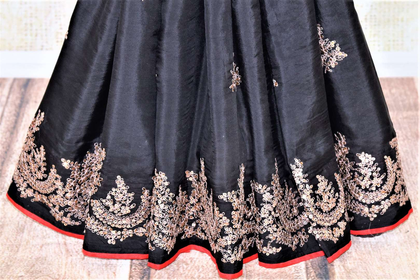 Shop stunning black silk saree online in USA with embroidered border. Be the center of attraction at weddings and parties with beautiful silk sarees, embroidered sarees, partywear sarees, fancy sarees from Pure Elegance Indian fashion store in USA. -pleats