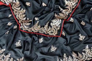 Shop stunning black silk saree online in USA with embroidered border. Be the center of attraction at weddings and parties with beautiful silk sarees, embroidered sarees, partywear sarees, fancy sarees from Pure Elegance Indian fashion store in USA. -details