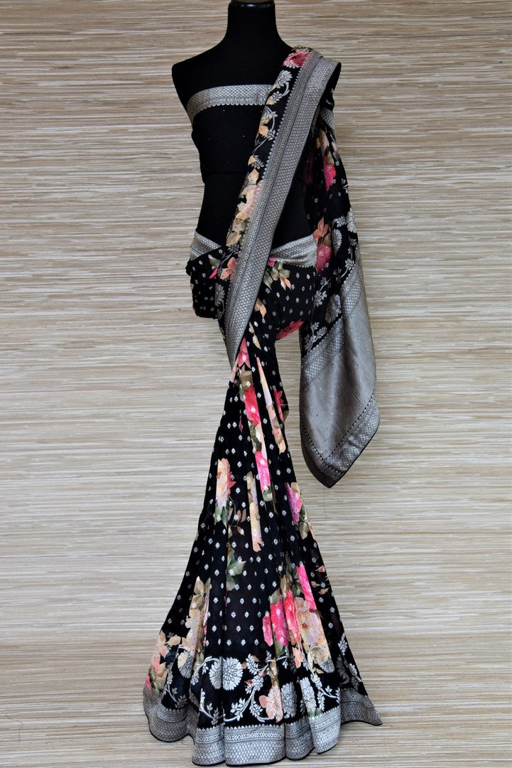 Shop ravishing black floral print georgette Benarasi sari online in USA with stone work. Be the highlight of the parties and festive occasions with tasteful Banarasi sarees, georgette saris, embroidered designer sarees from Pure Elegance Indian fashion store in USA.-full view