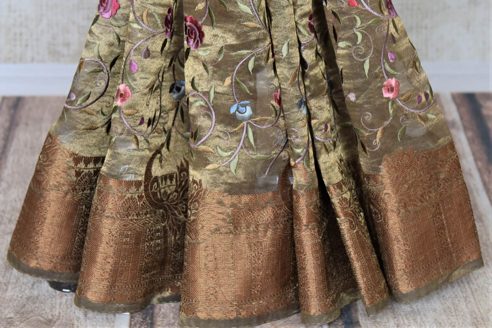 Buy gorgeous golden embroidered metallic linen sari online in USA. Be the talk of the occasions in exquisite linen sarees, embroidered saris from Pure Elegance Indian fashion store in USA. -pleats