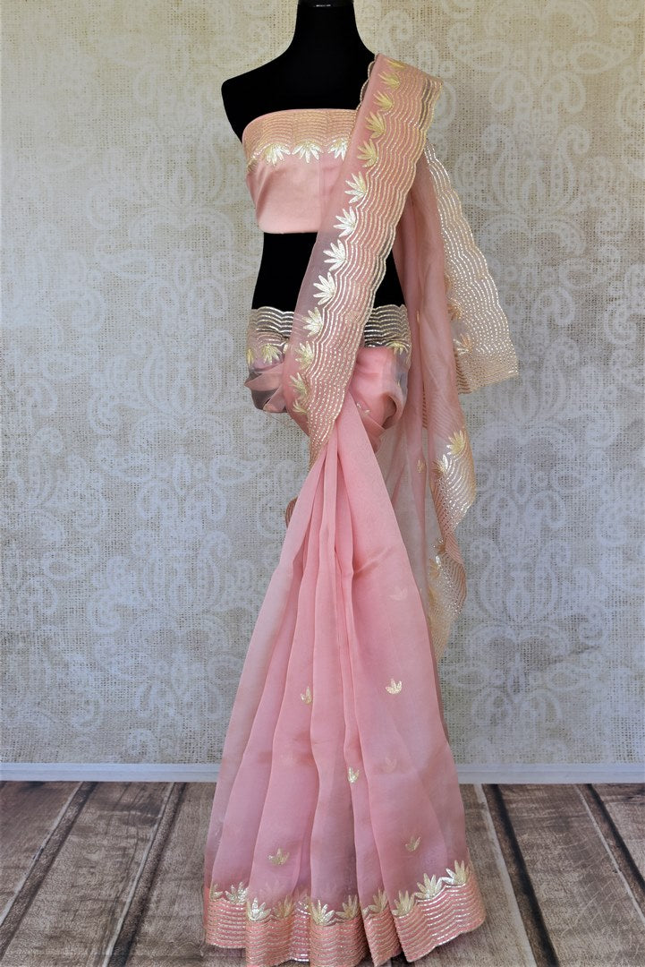 Shop stunning baby pink organza saree online in USA with gota work border. Keep it light yet festive on special occasions with beautiful organza silk saris from Pure Elegance Indian fashion store in USA.-full view