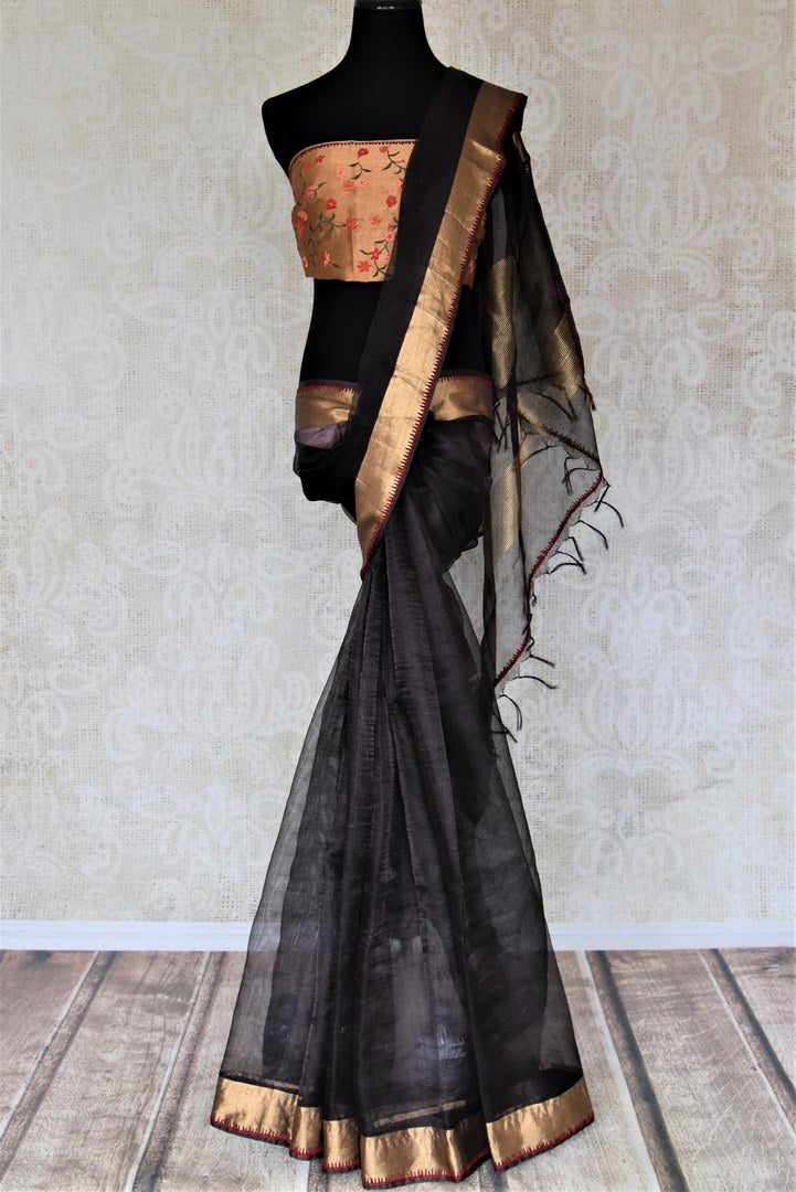 Shop elegant black metallic linen saree online in USA with golden zari border. Be the talk of the occasions in exquisite linen sarees, embroidered saris from Pure Elegance Indian fashion store in USA. -full view