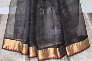 Shop elegant black metallic linen saree online in USA with golden zari border. Be the talk of the occasions in exquisite linen sarees, embroidered saris from Pure Elegance Indian fashion store in USA. -pleats