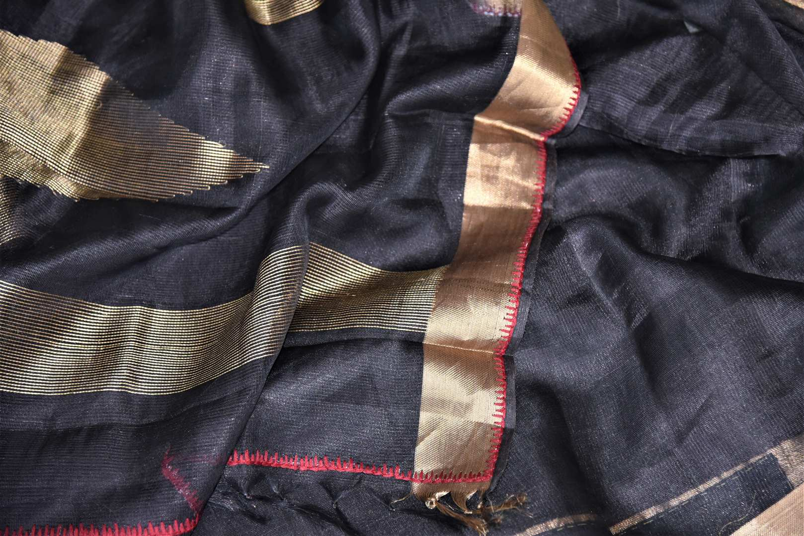 Shop elegant black metallic linen saree online in USA with golden zari border. Be the talk of the occasions in exquisite linen sarees, embroidered saris from Pure Elegance Indian fashion store in USA. -details