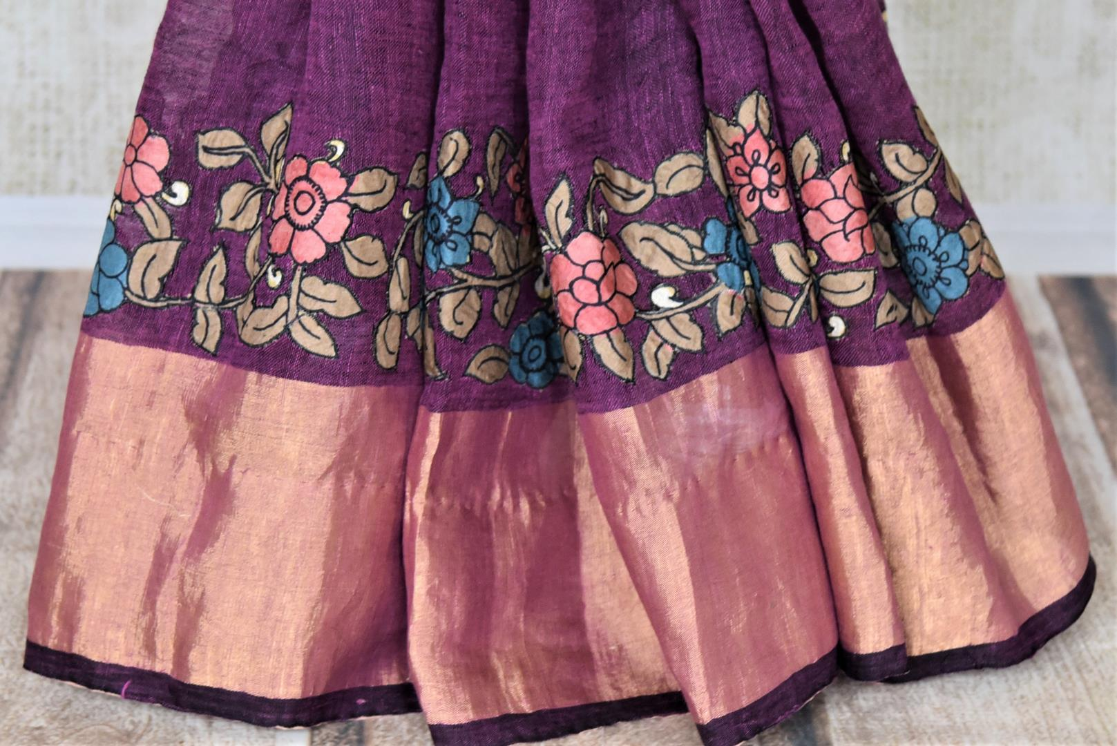 Buy beautiful purple linen sari online in USA with hand painted Kalamkari applique. Be the talk of the occasions in exquisite linen sarees, embroidered saris from Pure Elegance Indian fashion store in USA. -pleats
