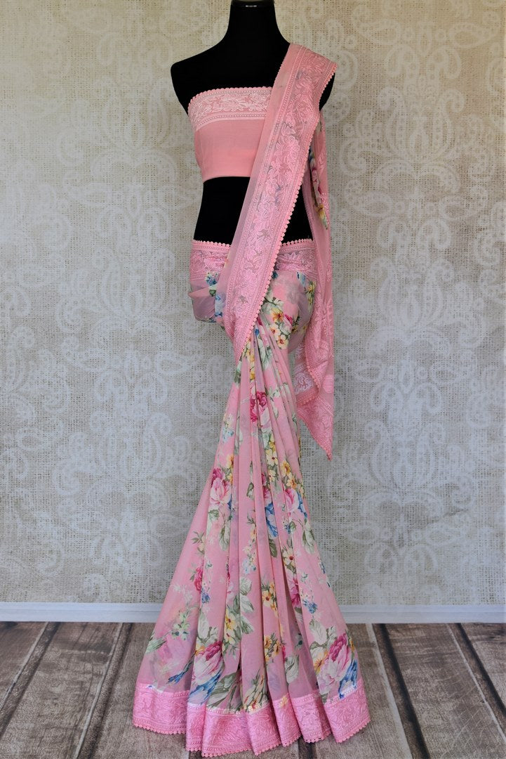 Buy soft pink printed chiffon saree online in USA with embroidered border. Be the talk of the occasions in exquisite linen sarees, embroidered saris from Pure Elegance Indian fashion store in USA. -full view