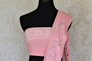 Buy soft pink printed chiffon saree online in USA with embroidered border. Be the talk of the occasions in exquisite linen sarees, embroidered saris from Pure Elegance Indian fashion store in USA. -blouse pallu