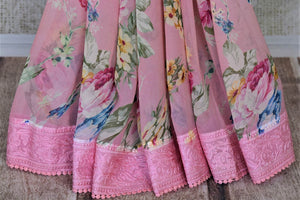Buy soft pink printed chiffon saree online in USA with embroidered border. Be the talk of the occasions in exquisite linen sarees, embroidered saris from Pure Elegance Indian fashion store in USA. -details