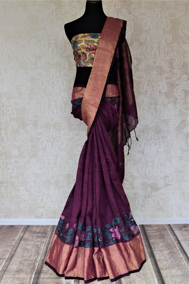 Shop purple color handpainted Kalamkari applique linen saree online in USA with golden zari border. Be the talk of the occasions in exquisite linen sarees, embroidered saris from Pure Elegance Indian fashion store in USA. -full view
