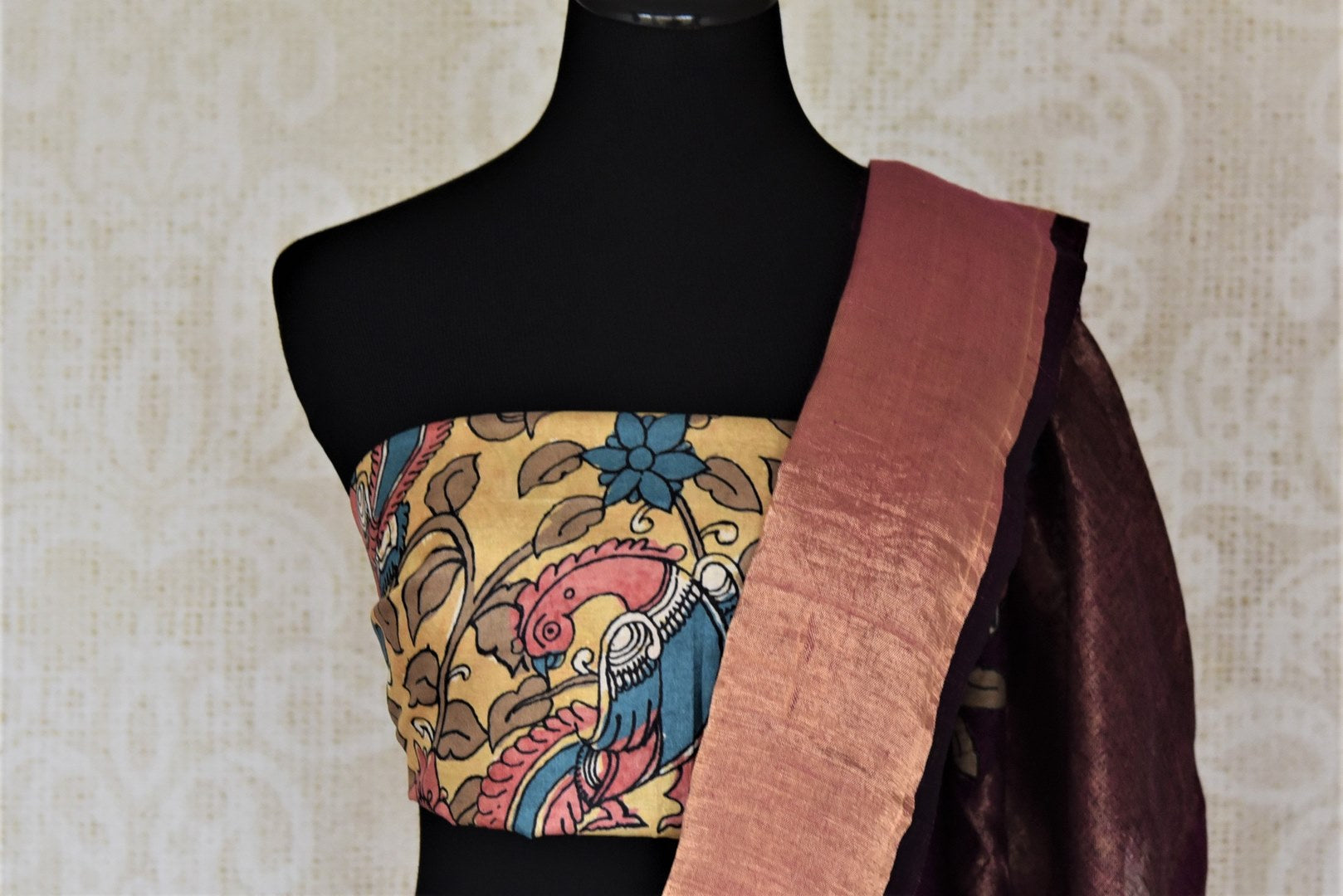 Buy purple linen sari online in USA with Kalamkari applique and golden zari border. Be the talk of the occasions in exquisite linen sarees, embroidered saris from Pure Elegance Indian fashion store in USA. -blouse pallu