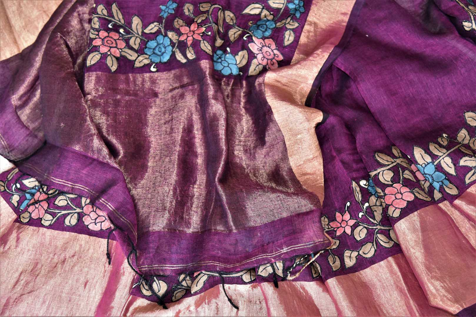 Buy purple linen sari online in USA with Kalamkari applique and golden zari border. Be the talk of the occasions in exquisite linen sarees, embroidered saris from Pure Elegance Indian fashion store in USA. -details