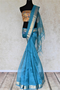 Shop light blue metallic linen saree online in USA with silver zari border. Be the talk of the occasions in exquisite linen sarees, embroidered saris from Pure Elegance Indian fashion store in USA. -full view