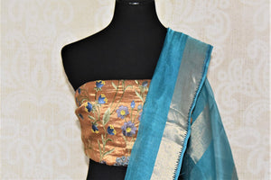 Shop light blue metallic linen saree online in USA with silver zari border. Be the talk of the occasions in exquisite linen sarees, embroidered saris from Pure Elegance Indian fashion store in USA. -blouse pallu