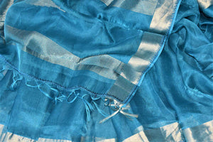 Shop light blue metallic linen saree online in USA with silver zari border. Be the talk of the occasions in exquisite linen sarees, embroidered saris from Pure Elegance Indian fashion store in USA. -details