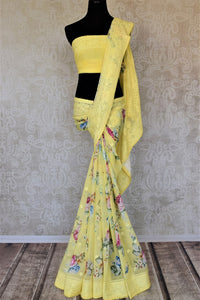 Buy beautiful lemon yellow floral georgette saree online in USA with embroidered border. Be the talk of the occasions in exquisite linen sarees, embroidered saris from Pure Elegance Indian fashion store in USA. -full view