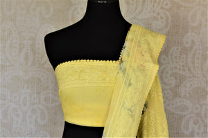 Buy beautiful lemon yellow floral georgette saree online in USA with embroidered border. Be the talk of the occasions in exquisite linen sarees, embroidered saris from Pure Elegance Indian fashion store in USA. -blouse pallu