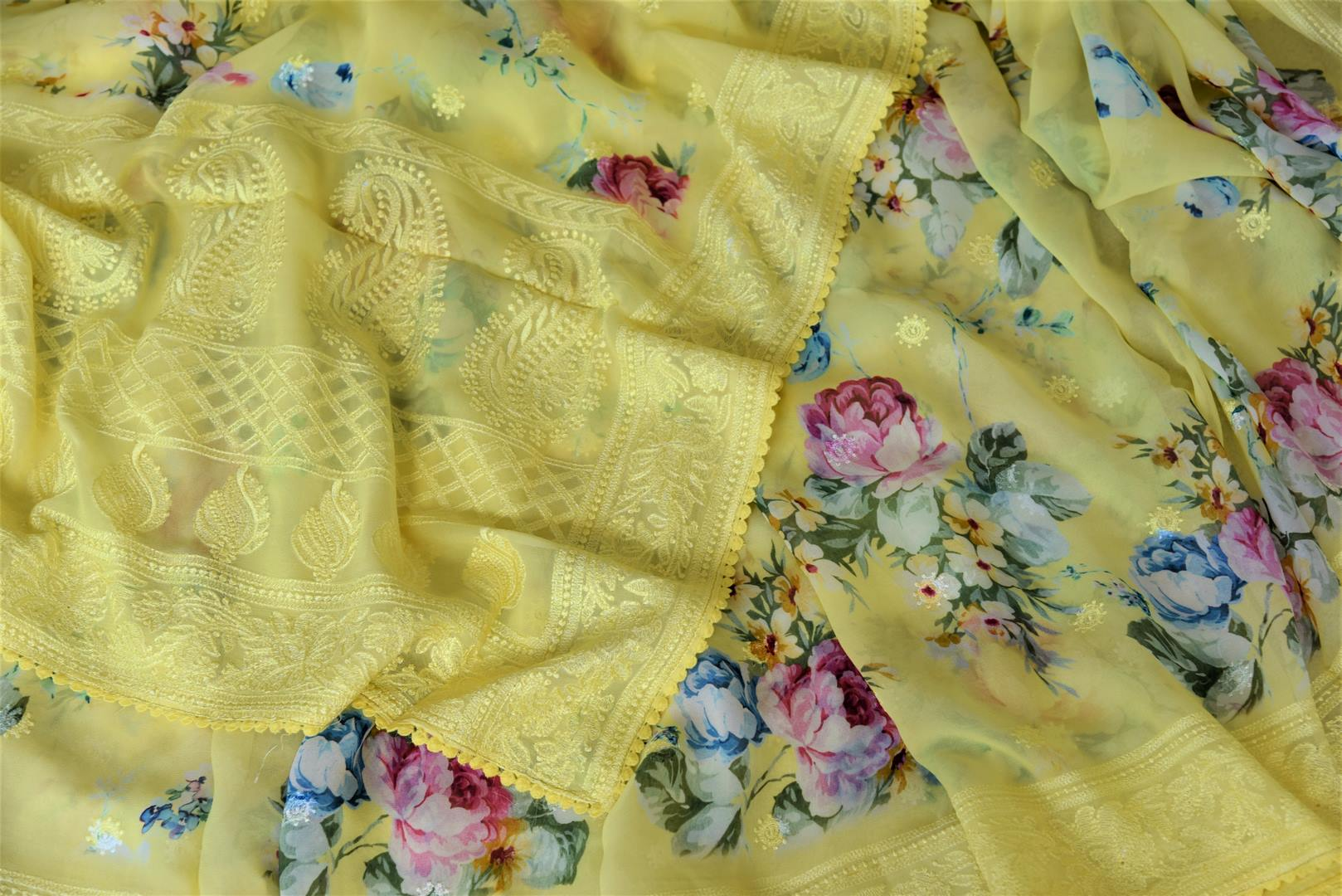 Buy beautiful lemon yellow floral georgette saree online in USA with embroidered border. Be the talk of the occasions in exquisite linen sarees, embroidered saris from Pure Elegance Indian fashion store in USA. -details